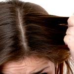 Fingers through hair